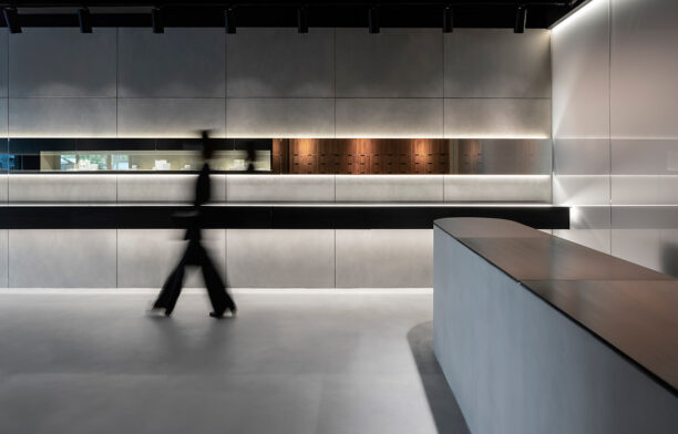 The retail interior design of Sarah & Sebastian's Mosman store is characterised by key materials such as concrete, walnut, blackened steel, mirror and frosted glass are layered to form a harmonious balance between light and dark; floating and solid; and lightweight and heavy elements.