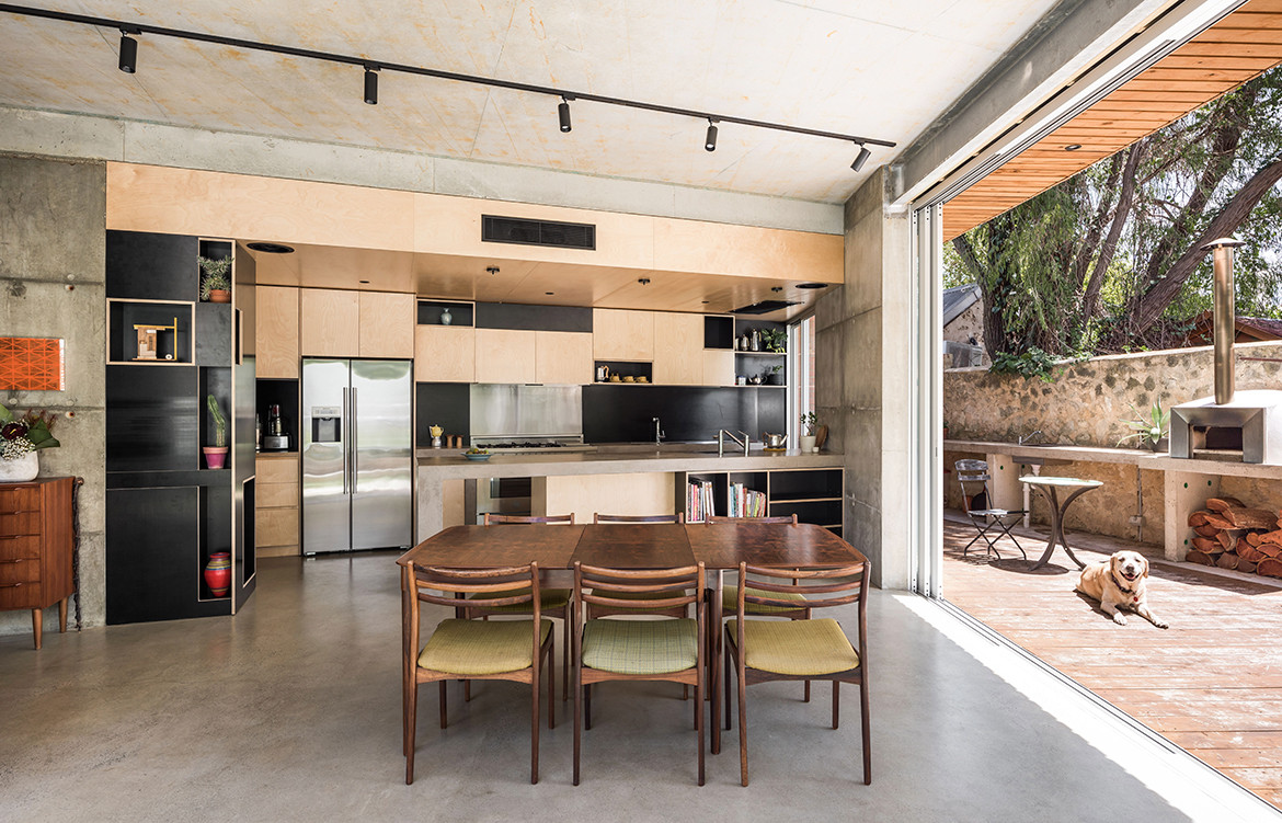 Silver Street House EHDO Architecture CC Dion Robeson dining kitchen and exterior fireplace