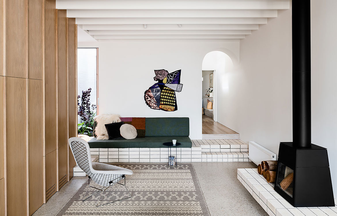 The interior design of Storybook House by Folk Architects, a Victorian terrace extension, features timber wall panelling, terrazzo flooring and built-in furniture finished with subway tiles.