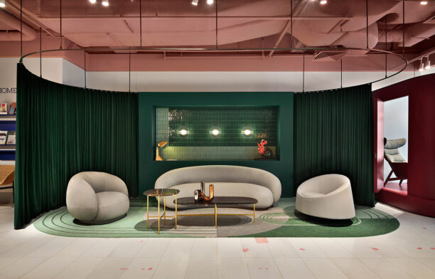 Julep lounge and armchairs by Tacchini set against emerald velvet curtains at Stylecraft Singapore