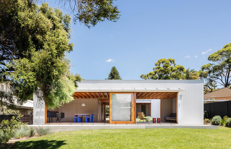 The white wooden exterior of Tribe Studio Architect's Bundeena Kit-Home.