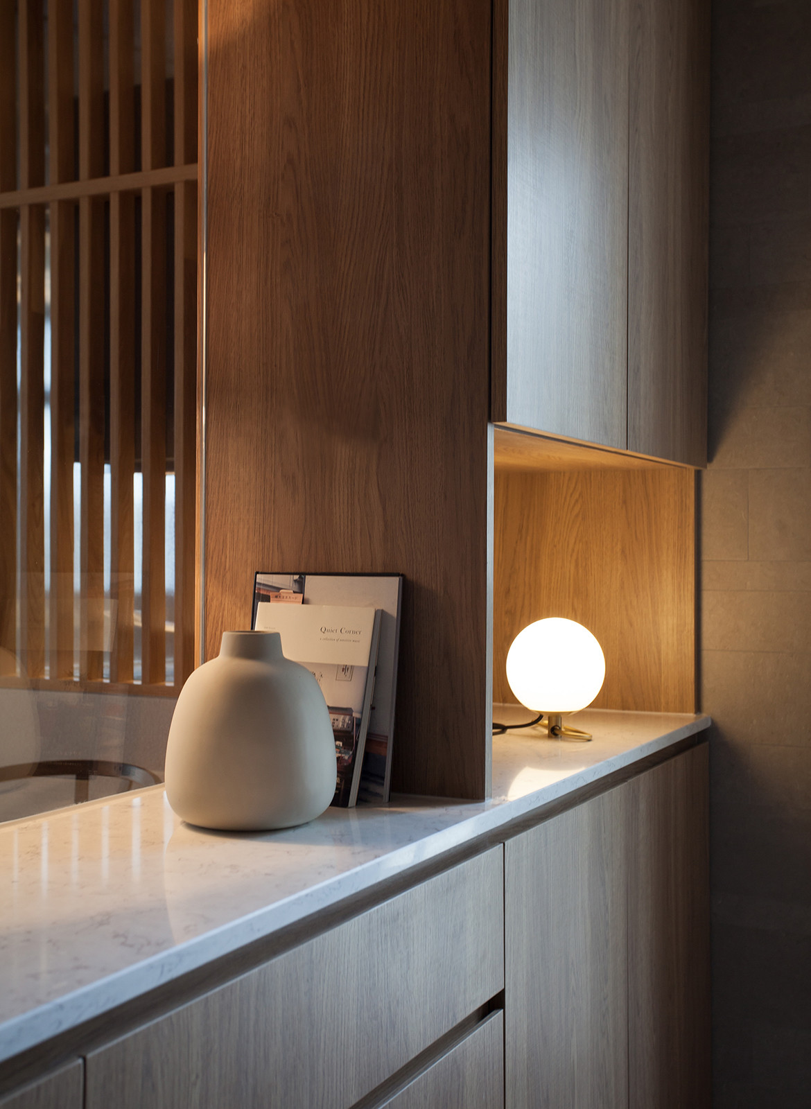 Taikoo Shing Apartment Studio Adjective lighting on kitchen bench