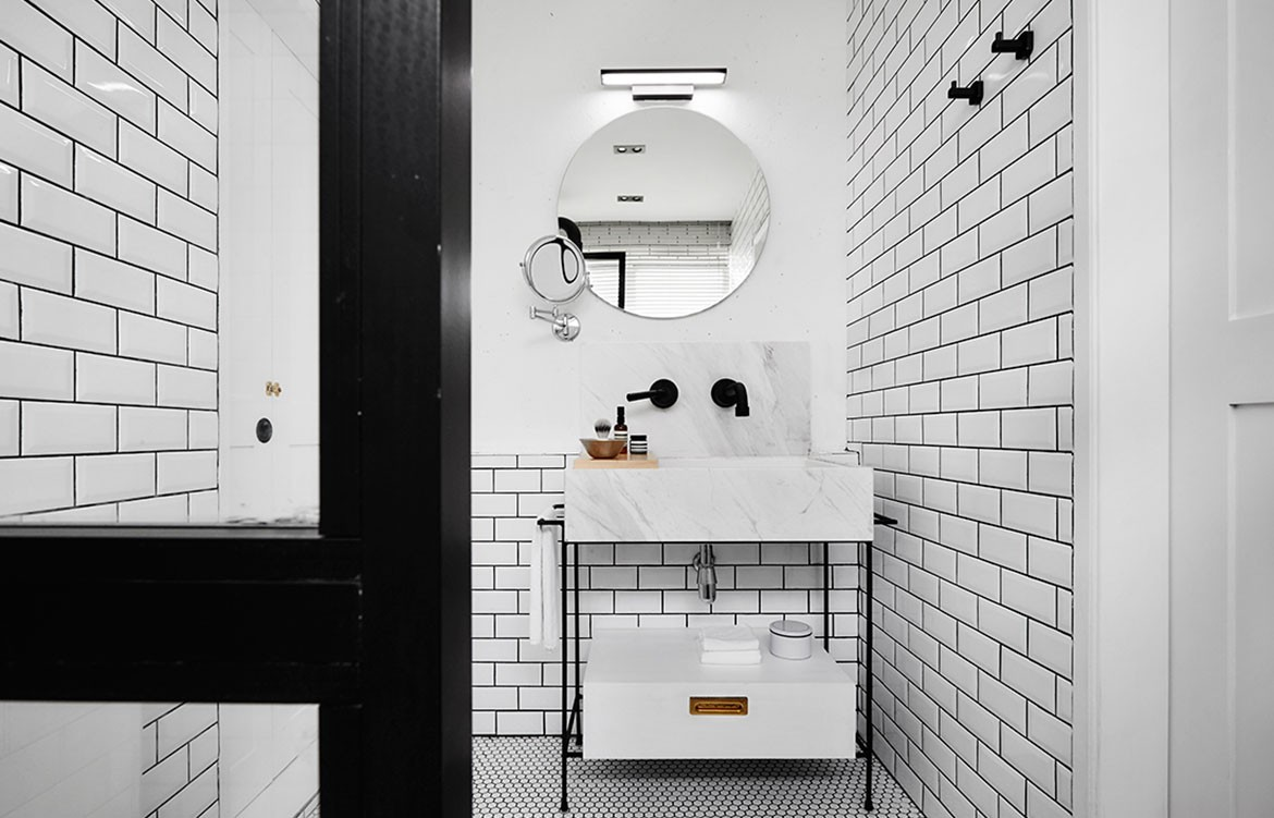 UpStairs white brick house bathroom