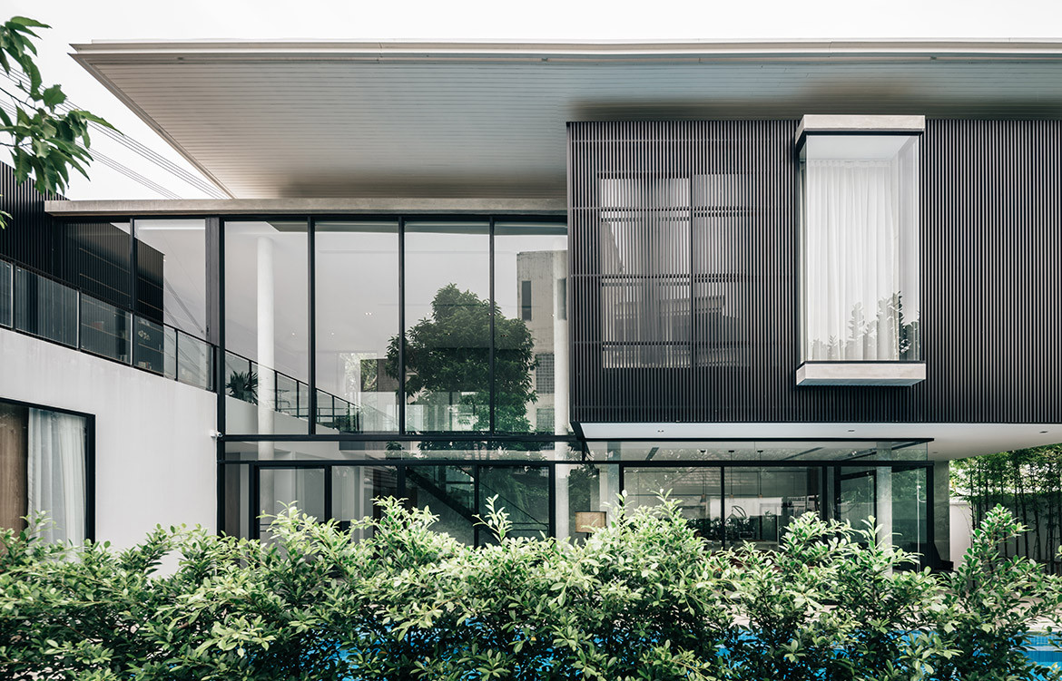 bAAN House Anonym Studio CC Chaovarith Poonphol side elevation facade with greenery