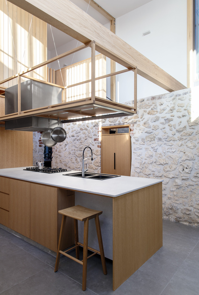 The historic limestone kitchen of Orient Street House by Philip Stejskal