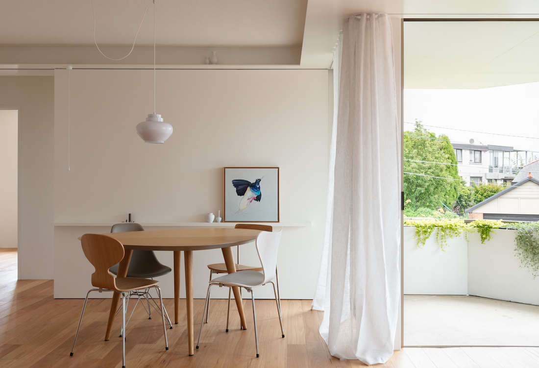 Sliding wall and small circular dining table, next to an open sliding door.